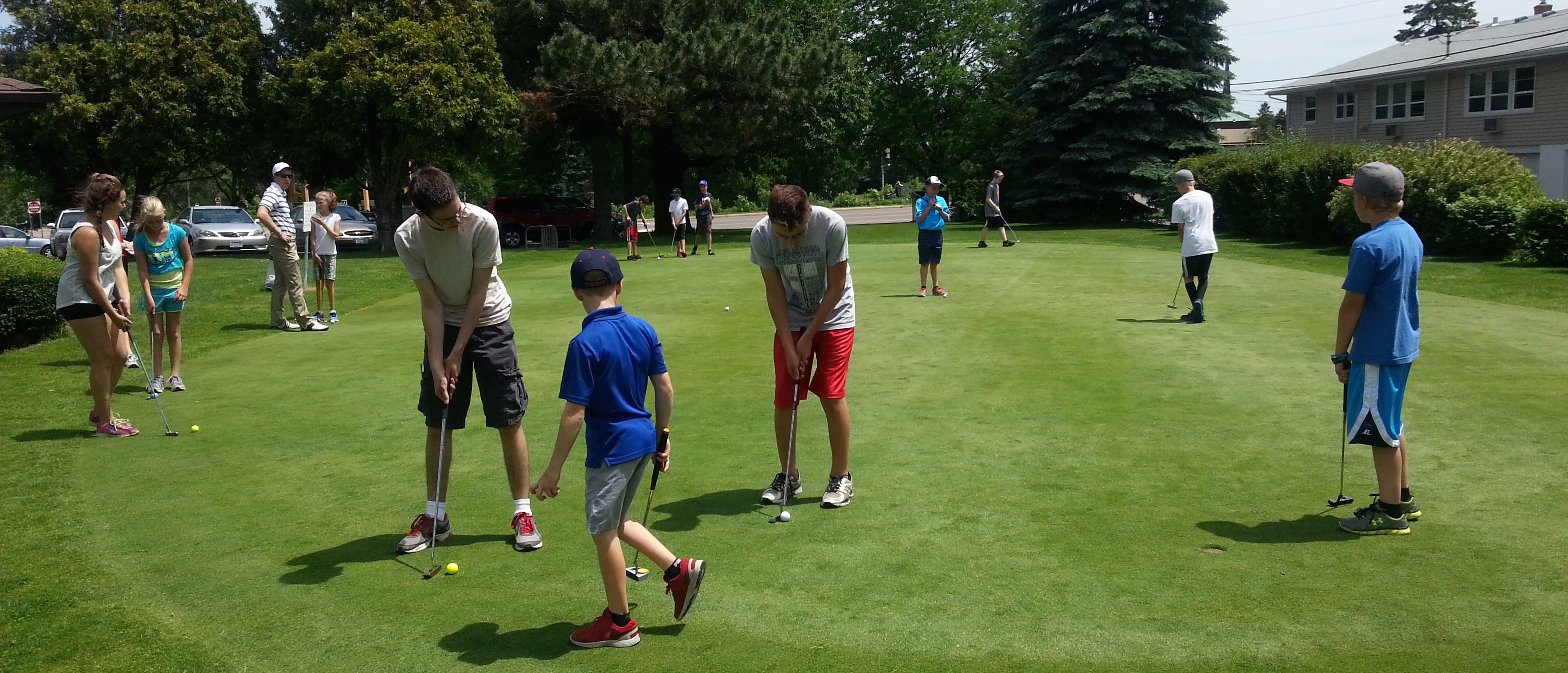 Young golfers on putting green