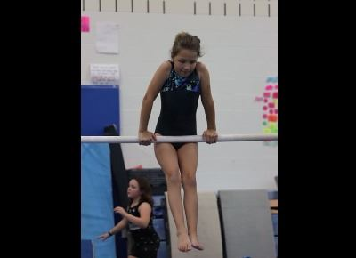 Gymnastics - girl on bar