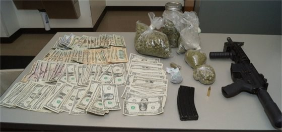 Cash, Marijuana, and an assault rifle.