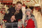 Lt. Adams and partner at Shop with a Cop