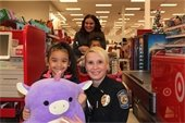 Deputy Chief Scheider with partner at Shop with a Cop