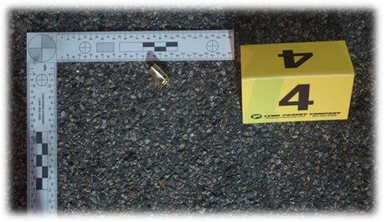 One of the eight 9mm casings found.